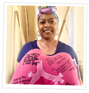 Latasha, double lung recipient holding a lung pillow with encouraging messages