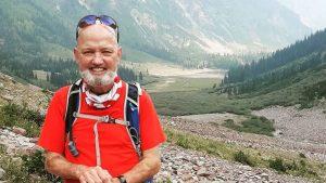 David Skalski, transplant recipient, with mountain range in background